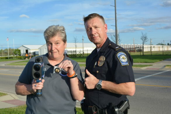 Woman posing with officer