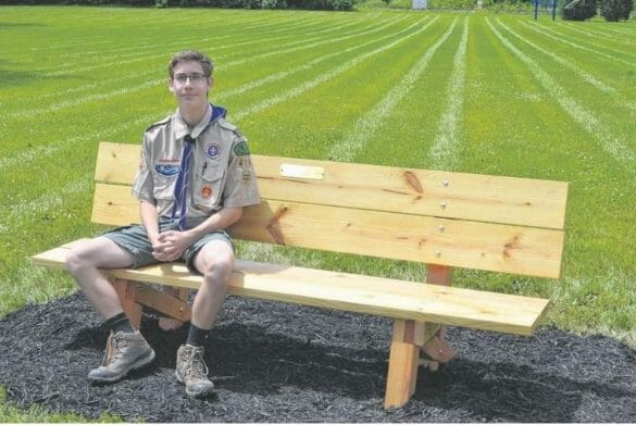 Eagle Scout sitting on bench