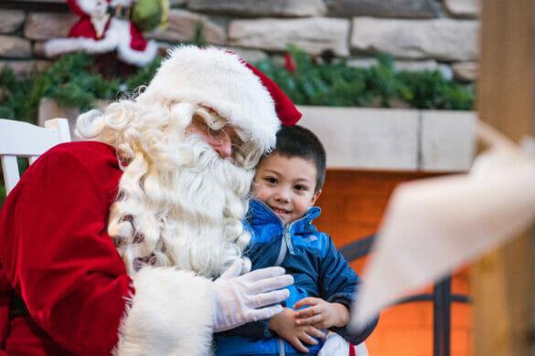 Child posing with Santa