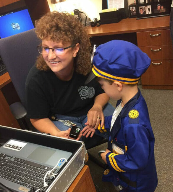 Officer Hyda helping a child do an EZ id