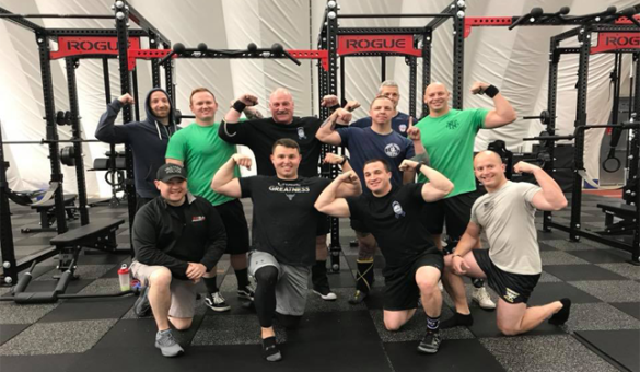officers posing and flexing at a gym