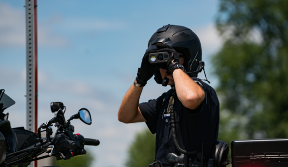 Officer looking through binoculars