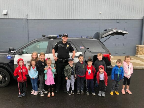Officer Agosta with Maxwell and his friends
