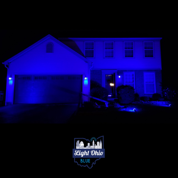 A house lit blue for police