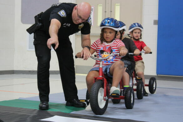 Officer instructing kids at Safety Town