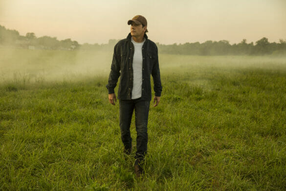 Country singer Rodney Atkins walking through a field