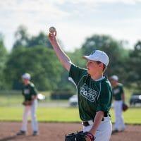 Teen boy throwing baseball