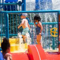 Kids playing at the pool on splash pad