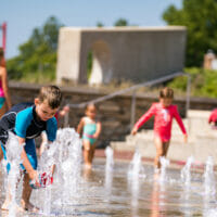 Children playing at the fountains of Hilliard's Station Park