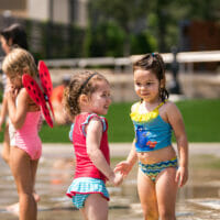Kids playing at the fountains