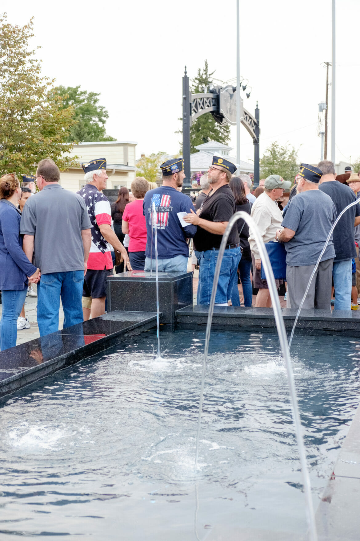 Residents in front of fountain at First Responders Park