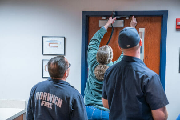 Man checking door during active shooter training