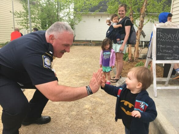 Officer high fiving a little boy