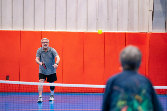 an older man playing pickle ball