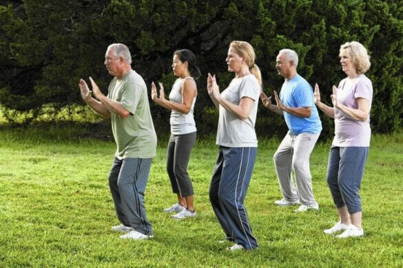 senior citizens performing tai chi outside