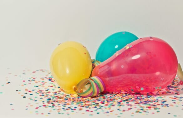 Close up of colorful balloons and confetti