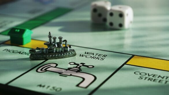 A monopoly board with the boat piece on water works
