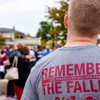 residents at 9/11 ceremony at first responders park