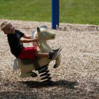 Little boy on rocking horse