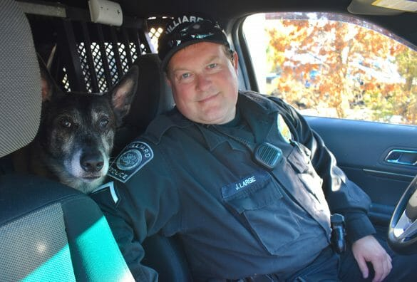 Officer Large and K9 Oz in vehicle