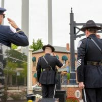 Officers saluting flag
