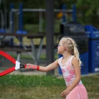 A girl playing badminton