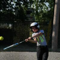 A girl hitting a ball