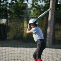 A girl holding a bat