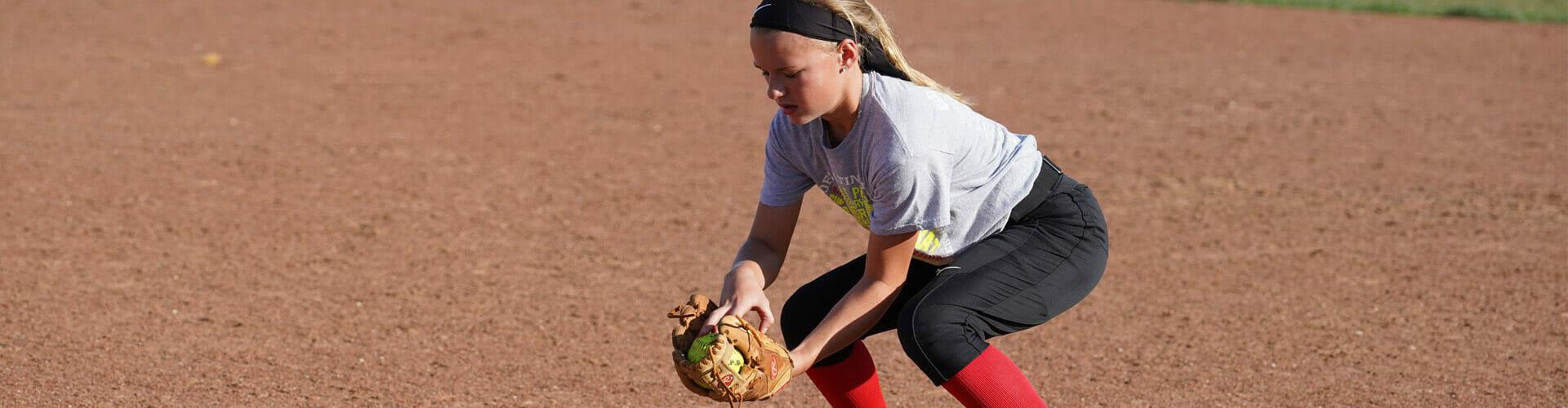 Banner of girl picking up ball