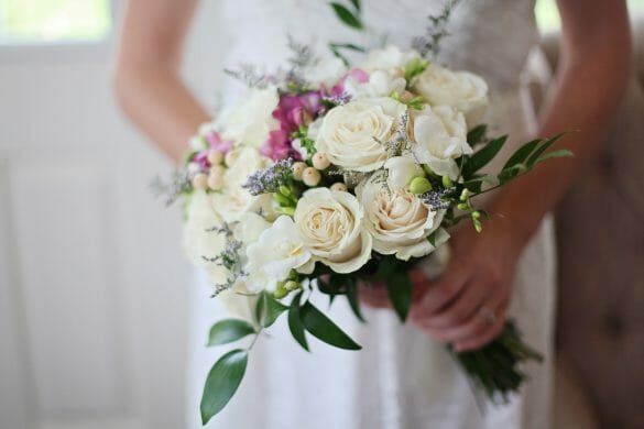 close up of woman holding bridal bouquet