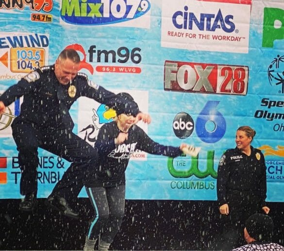 Chief Fisher and his wife jumping into polar plunge