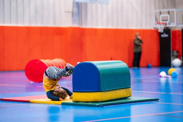 Boy tumbling in gym
