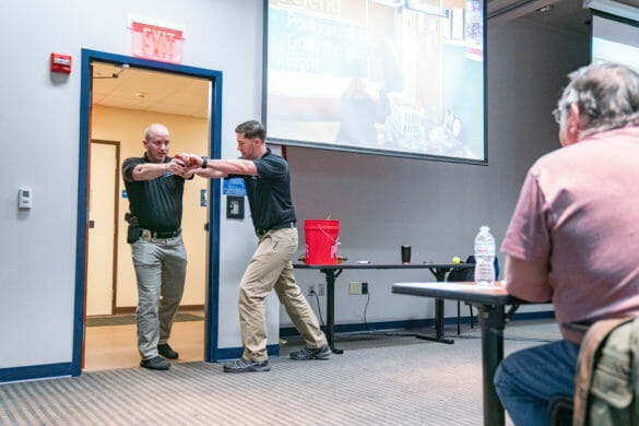 Officers demonstrating how to disarm an active shooter during CRASE training