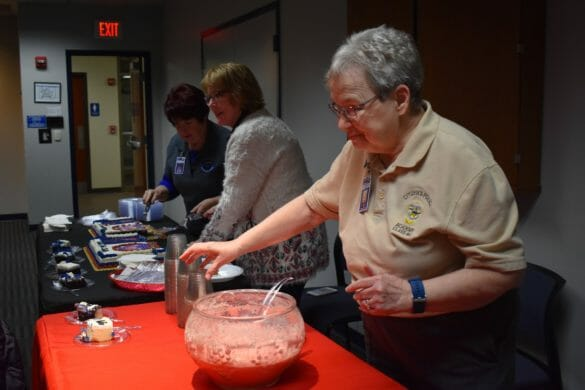 CPA volunteers serving punch at an event
