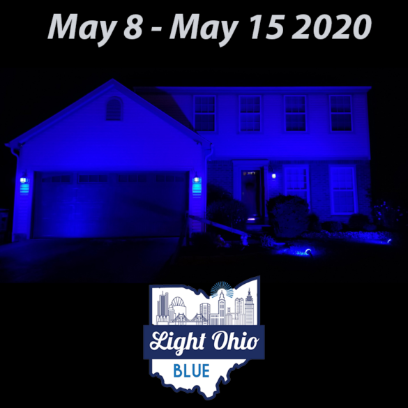 A house at night lit up with a blue light