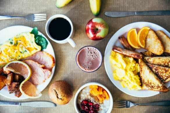 A table with a variety of breakfast food and drinks
