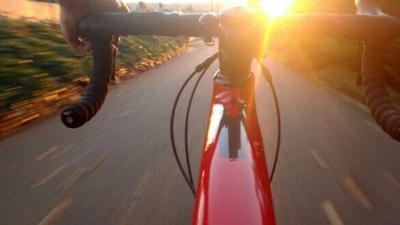 A bike being ridden quickly, everything blurring around it.