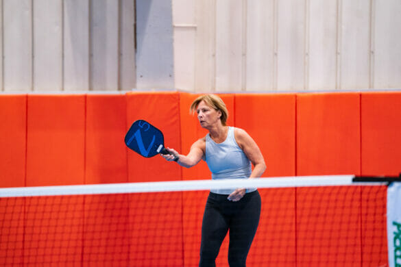 Woman playing pickleball