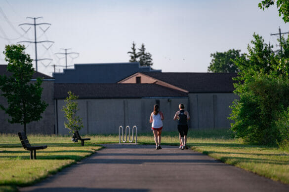 Two women jogging on park trail