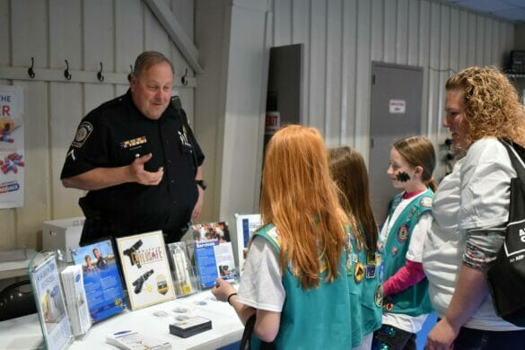 Officer Deaton talking to a group of girl scouts
