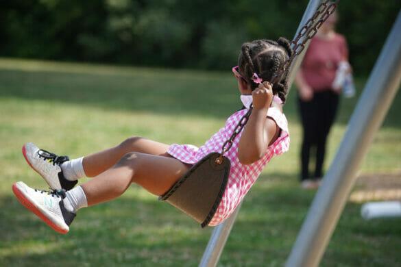 A little girl swinging