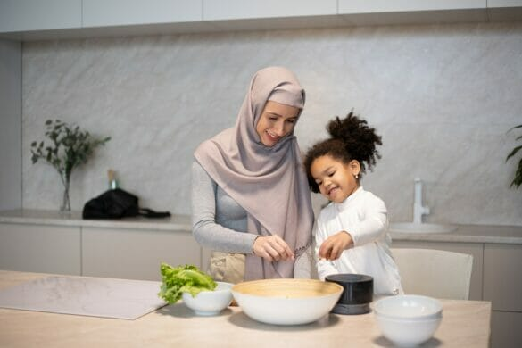 A mom and daughter cooking in the kitchen