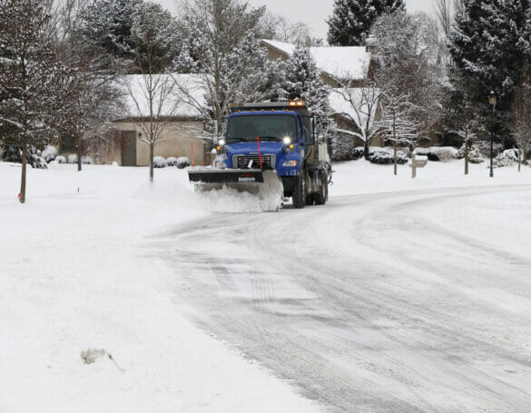 Snow plow plowing the roads