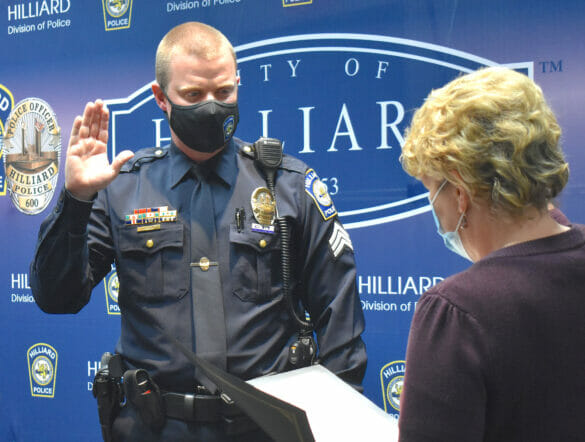 Sergeant Chad Wood being sworn in