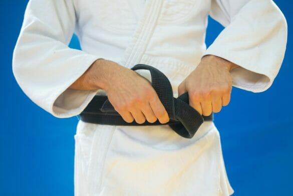 Person tightening black belt