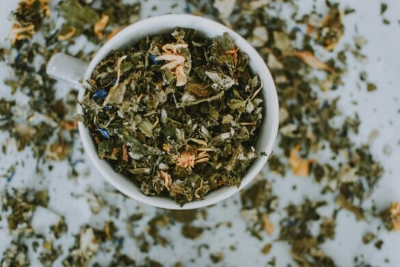a cup overflowing with tea leaves