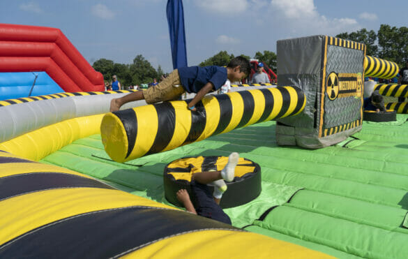 Boys playing on an inflatable obstacle course