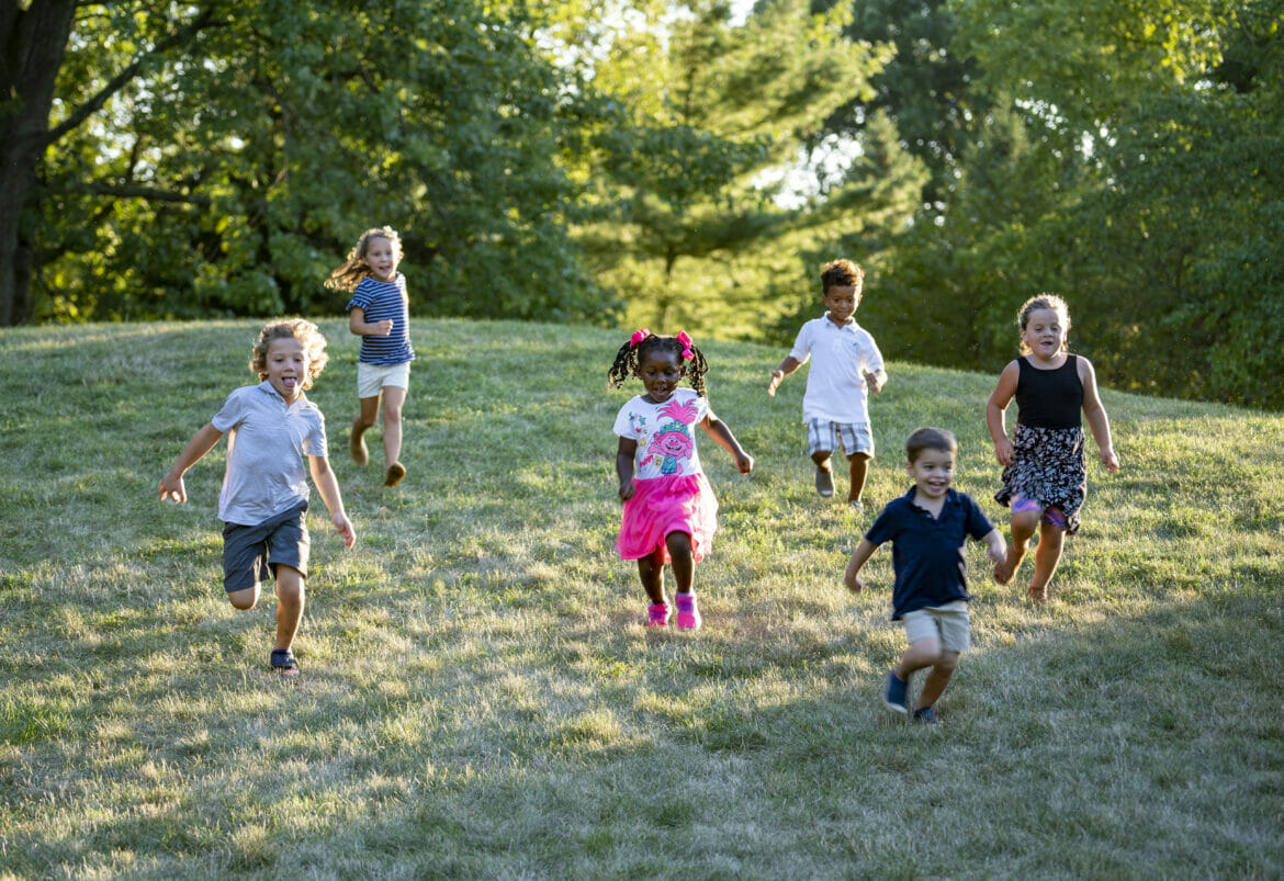 A group of kids running down a hill