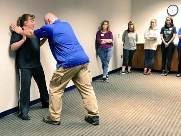 Police instructor teaching self-defense