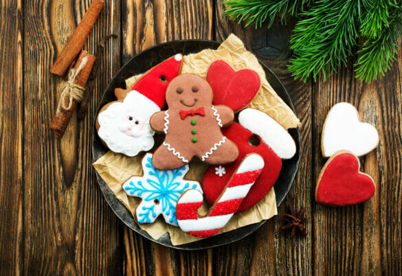 a plate of variously decorated Christmas cookies